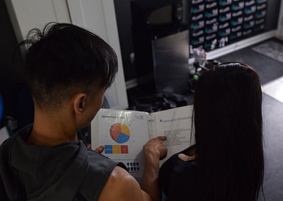 andy and claudia reviewing exercise plan at lux fit