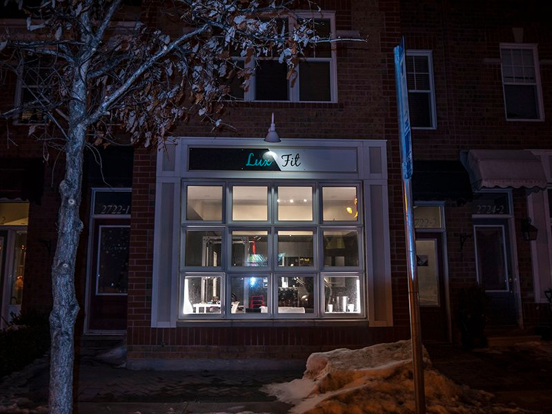 lux fit personal training studio store front in the night