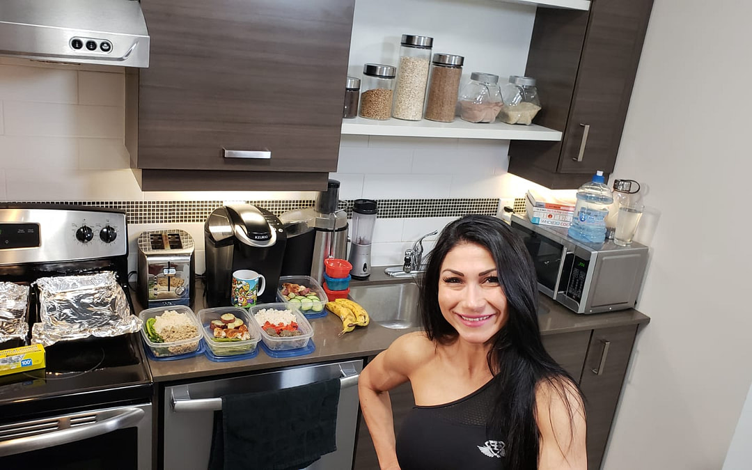 meal prep at home kitchen with fit female personal trainer
