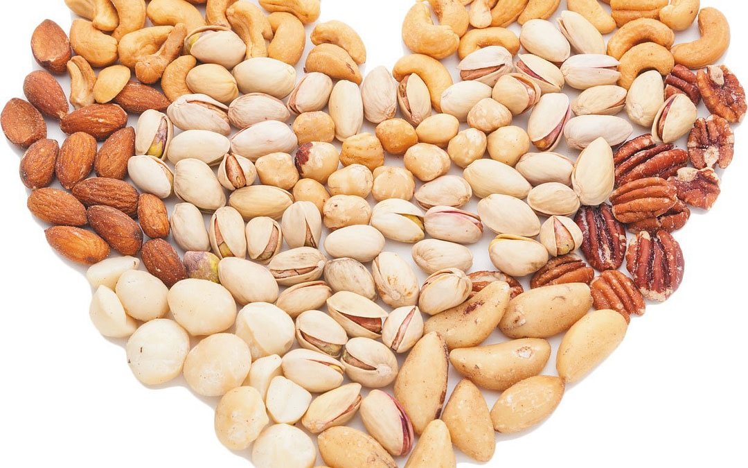 different nuts form a heart shape
