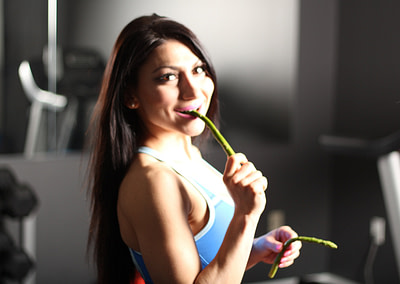 trainer eating an asparagus in training studio