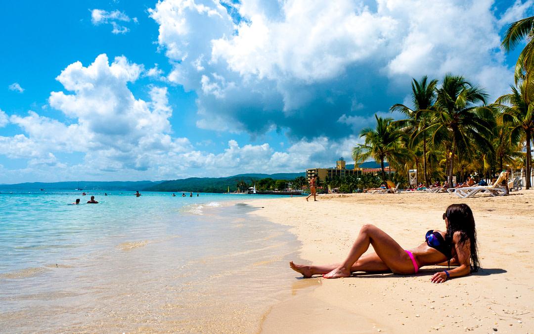 fit girl on the beach in a bikini