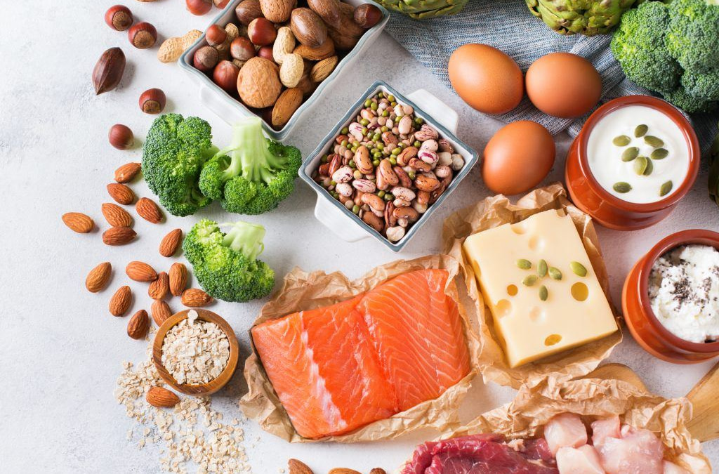 picture of healthy protein including salmon, eggs and cheese